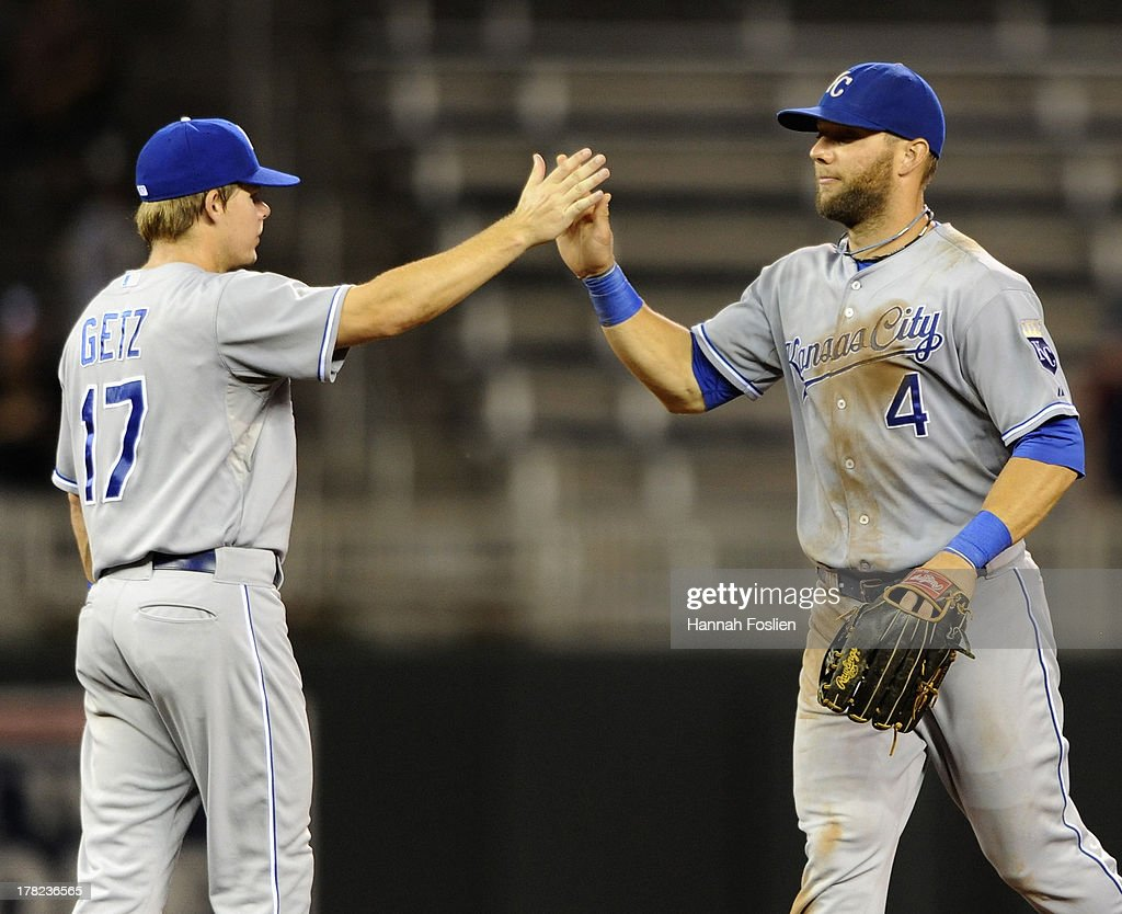 Chris Getz #17 and Alex Gordon #4 of the Kansas City Royals celebrate a win of the game against the Minnesota Twins on August 27, 2013 at Target Field in Minneapolis, Minnesota. The Royals defeated the Twins 6-1.