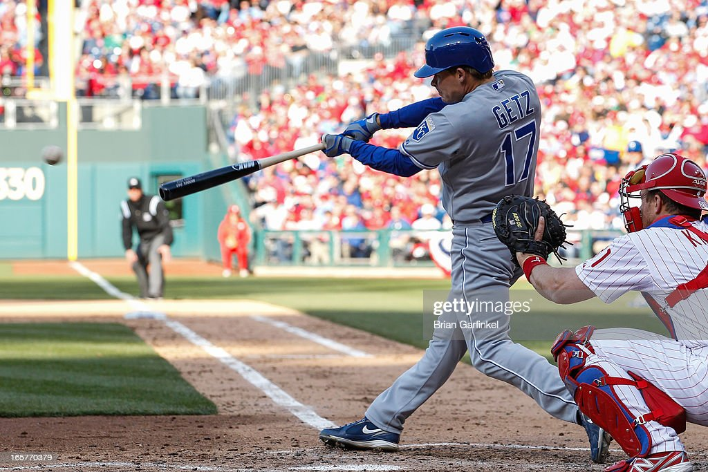 Chris Getz #17 of the Kansas City Royals gets a base hit in the fifth inning of the Opening Day game against the Philadelphia Phillies at Citizens Bank Park on April 5, 2013 in Philadelphia, Pennsylvania. The Royals won 13 to 4.
