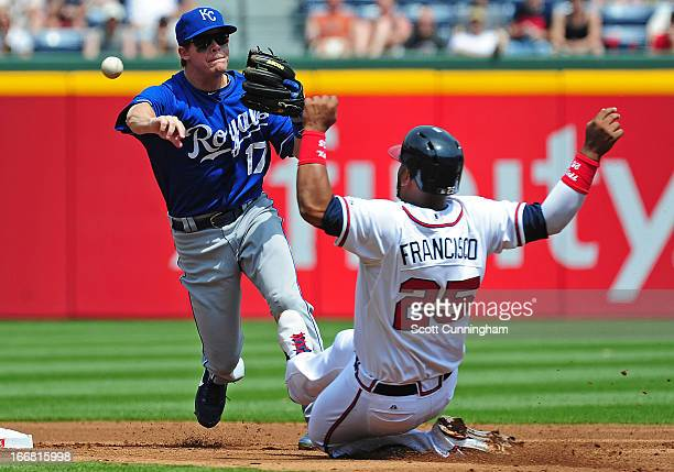 Chris Getz of the Kansas City Royals turns a double play against Juan Francisco of the Atlanta Braves at Turner Field on April 17 2013 in Atlanta...