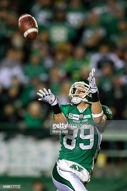 Chris Getzlaf of the Saskatchewan Roughriders hauls in a long pass in the second half of a game between the Calgary Stampeders and Saskatchewan...