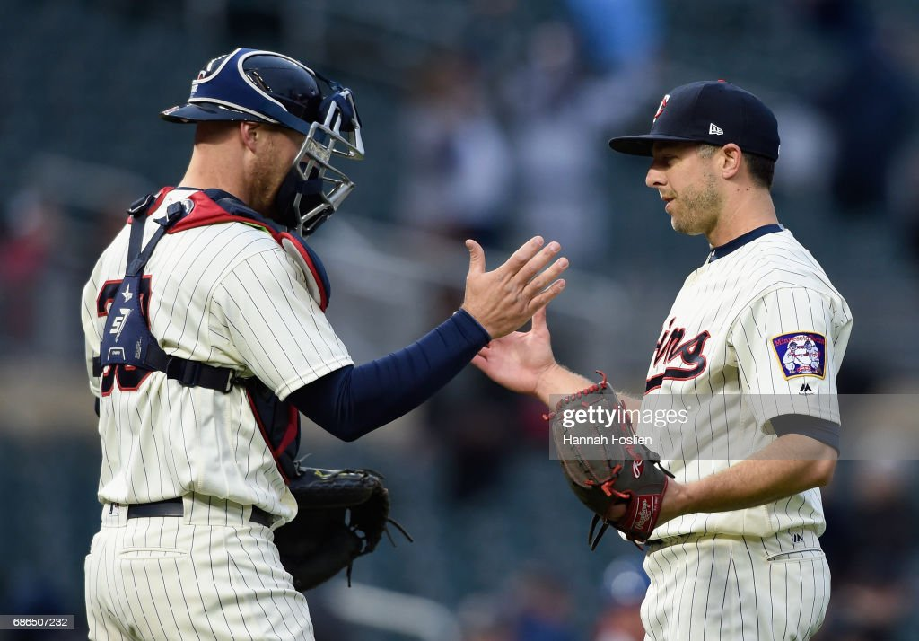 Chris Gimenez #38 and Brandon Kintzler #27 of the Minnesota Twins celebrate winning game two of a doubleheader against the Kansas City Royals on May 21, 2017 at Target Field in Minneapolis, Minnesota. The Twins defeated the Royals 8-4.