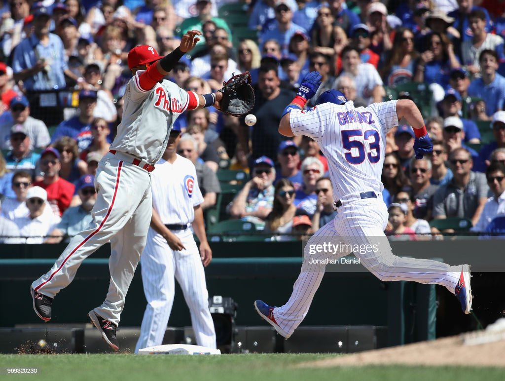 Chris Gimenez #53 of the Chicago Cubs beats the throw to Carlos Santana #41 of the Philadelphia Phillies in the 5th inning at Wrigley Field on June 7, 2018 in Chicago, Illinois.