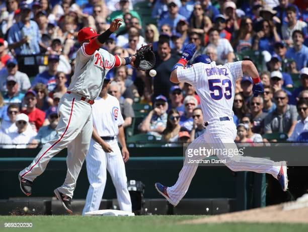 Chris Gimenez of the Chicago Cubs beats the throw to Carlos Santana of the Philadelphia Phillies in the 5th inning at Wrigley Field on June 7 2018 in...