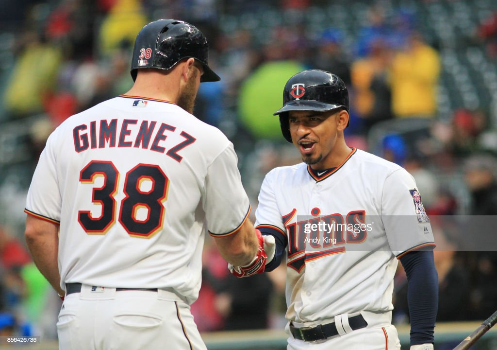 Chris Gimenez #38 of the Minnesota Twins is congratulated by Eduardo Escobar #5 of the Minnesota Twins after hitting a home run against the Detroit Tigers in the eighth inning during their baseball game on October 1, 2017, at Target Field in Minneapolis, Minnesota.