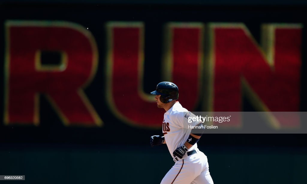 Chris Gimenez #38 of the Minnesota Twins rounds the bases after hitting a three-run home run against the Seattle Mariners during the first inning of the game on June 15, 2017 at Target Field in Minneapolis, Minnesota.