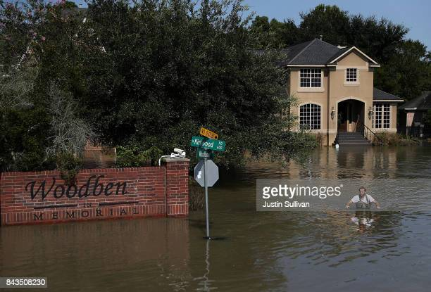 Chris Ginter wades through deep floodwaters on September 6 2017 in Houston Texas Houston resident Chris Ginter has been taking local residents to...