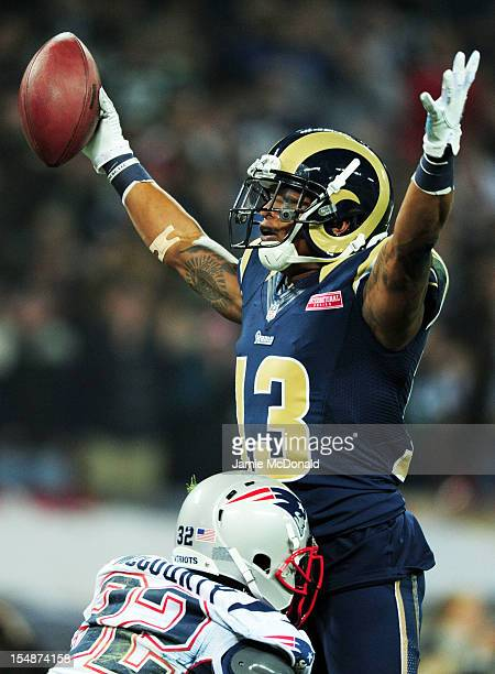Chris Givens of the St Louis Rams celebrates scoring the opening touchdown during the NFL International Series match between the New England Patriots...