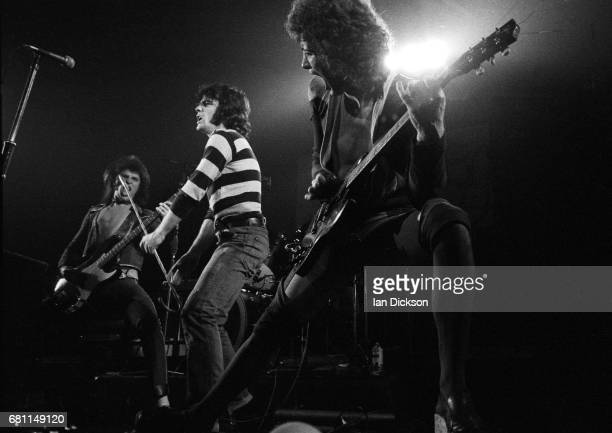 Chris Glen, Alex Harvey and Zal Cleminson of The Sensational Alex Harvey Band performing on stage at New Victoria Theatre, London, 23 December 1975.