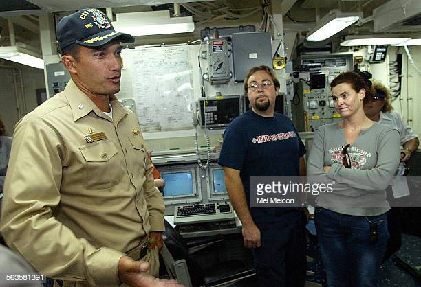Chris Godbille center and Lara Tobias members of the Oxnard Tourism Board listen to Commander Pat Piercey of the USS Howard a navy destroyer with...