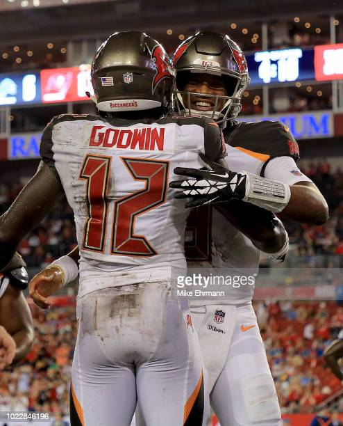 Chris Godwin and Jameis Winston of the Tampa Bay Buccaneers celebrate a touchdown during a preseason game against the Detroit Lions at Raymond James...