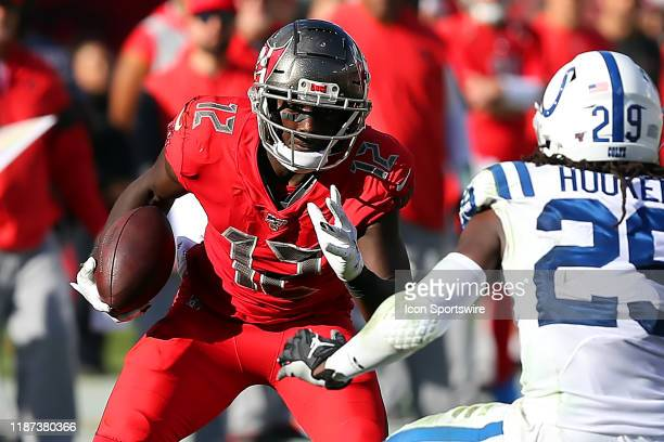 Chris Godwin of the Bucs gets some additional yardage after the catch during the regular season game between the Indianapolis Colts and the Tampa Bay...
