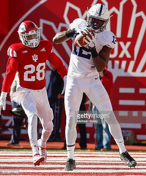 Chris Godwin of the Penn State Nittany Lions catches a pass in the end zone for a touchdown as AShon Riggins of the Indiana Hoosiers looks on at...