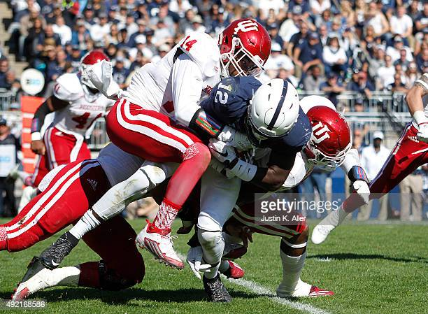 Chris Godwin of the Penn State Nittany Lions is tackled by Andre Brown Jr #14 of the Indiana Hoosiers in the second half during the game on October...