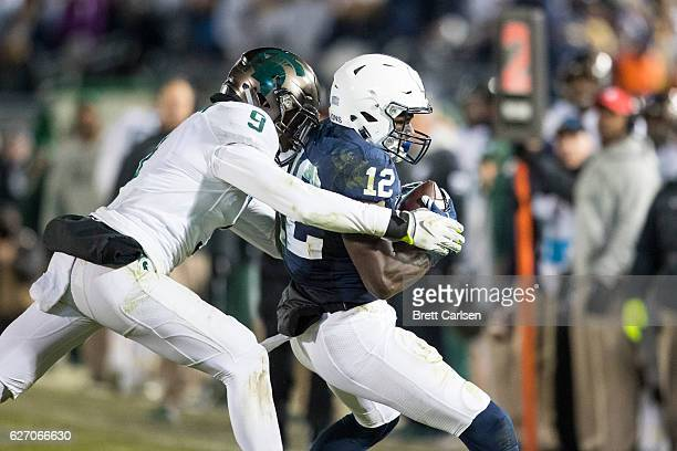 Chris Godwin of the Penn State Nittany Lions is tackled by Montae Nicholson of the Michigan State Spartans during the second half on November 26 2016...