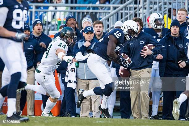 Chris Godwin of the Penn State Nittany Lions makes a reception as Grayson Miller of the Michigan State Spartans defends on November 26 2016 at Beaver...