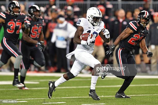 Chris Godwin of the Penn State Nittany Lions runs downfield on a 45yard pass reception in the first quarter against the Ohio State Buckeyes to set up...