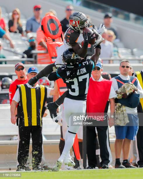 Chris Godwin of the Tampa Bay Buccaneers catches a pass against Tre Herndon of the Jacksonville Jaguars during the first quarter of a game at TIAA...