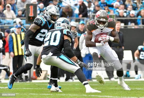 Chris Godwin of the Tampa Bay Buccaneers makes a catch against Kurt Coleman and Daryl Worley of the Carolina Panthers during their game at Bank of...