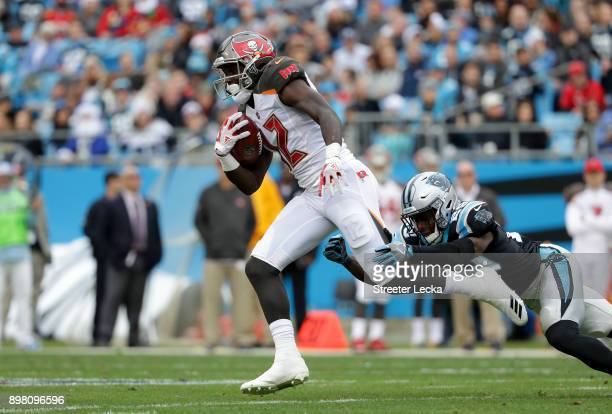 Chris Godwin of the Tampa Bay Buccaneers runs the ball against the Carolina Panthers in the second quarter during their game at Bank of America...