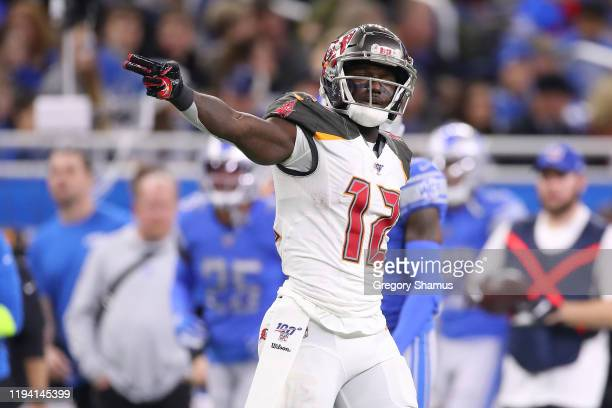 Chris Godwin of the Tampa Bay Buccaneers signals a first down after a first half catch against the Detroit Lions at Ford Field on December 15, 2019...