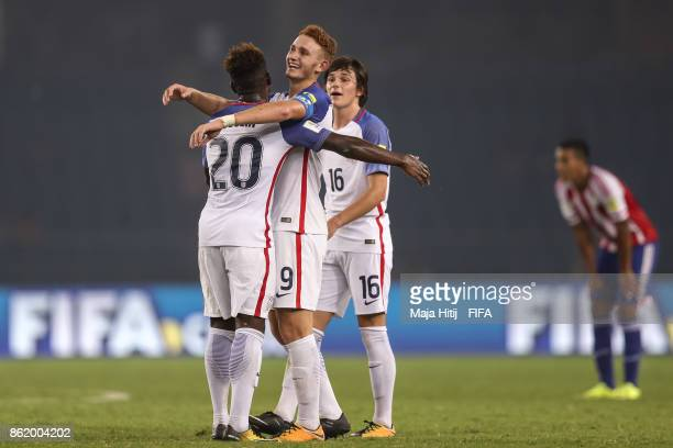 Chris Goslin Josh Sargent and Taylor Booth celebrate after the FIFA U17 World Cup India 2017 Round of 16 match between Paraguay and USA at Jawaharlal...