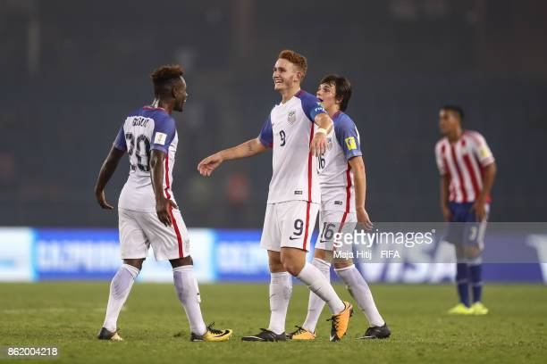 Chris Goslin Josh Sargent and Taylor Booth react after the FIFA U17 World Cup India 2017 Round of 16 match between Paraguay and USA at Jawaharlal...