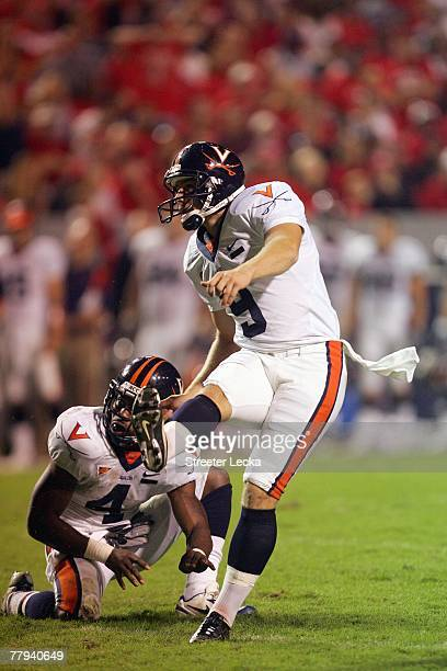 Chris Gould of the Virginia Cavaliers kicks a field goal during the game against the North Carolina State Wolfpack during their game at Carter-Finley...