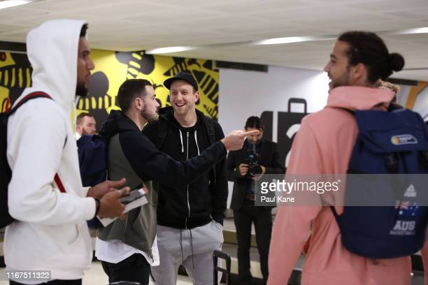 Chris Goulding and Joe Ingles of the Boomers chat after arriving at Perth Airport on August 12, 2019 in Perth, Australia.