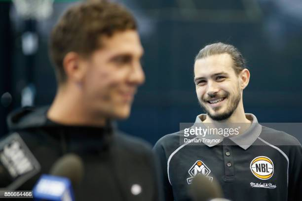 Chris Goulding laughs as Thanasi Kokkinakis speaks to the media during an Australian Open announcement at Melbourne Park on December 6 2017 in...