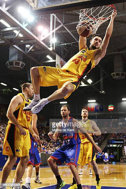 Chris Goulding of Melbourne dunks the ball during the round 23 NBL match between the Adelaide 36ers and the Melbourne Tigers at Adelaide Arena in...