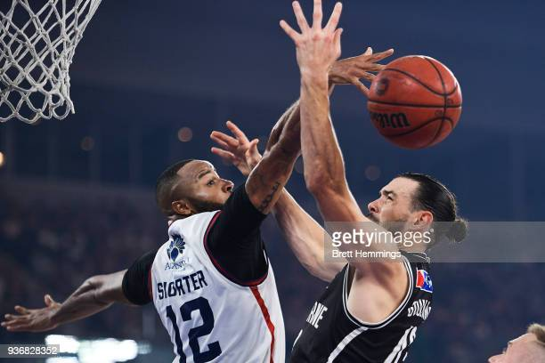 Chris Goulding of Melbourne is defended by Shannon Shorter of the 36ers during game three of the Grand Final series between Melbourne United and the...