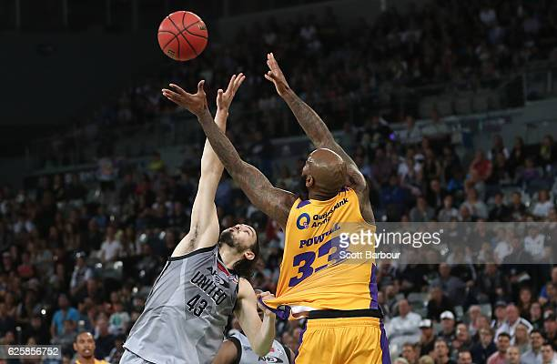 Chris Goulding of Melbourne United and Josh Powell of the Sydney Kings compete for the ball during the round eight NBL match between Melbourne United...