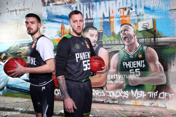 Chris Goulding of Melbourne United and Mitch Creek of South East Melbourne Phoenix pose for a portrait during a Melbourne NBL Throwdown Media...