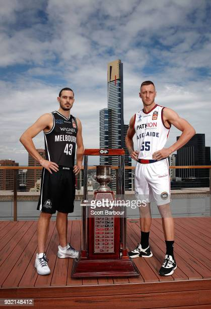 Chris Goulding of Melbourne United and Mitch Creek of the Adelaide 36ers pose with the Dr John Raschke Trophy during the NBL Grand Final media...