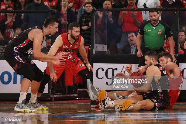 Chris Goulding of Melbourne United and Will Magnay of the Wildcats contest for a loose ball during game one of the NBL Grand Final Series between the...