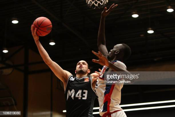 Chris Goulding of Melbourne United drives at the basket during the NBL Blitz pre-season match between Melbourne United and the Adelaide 36ers at...