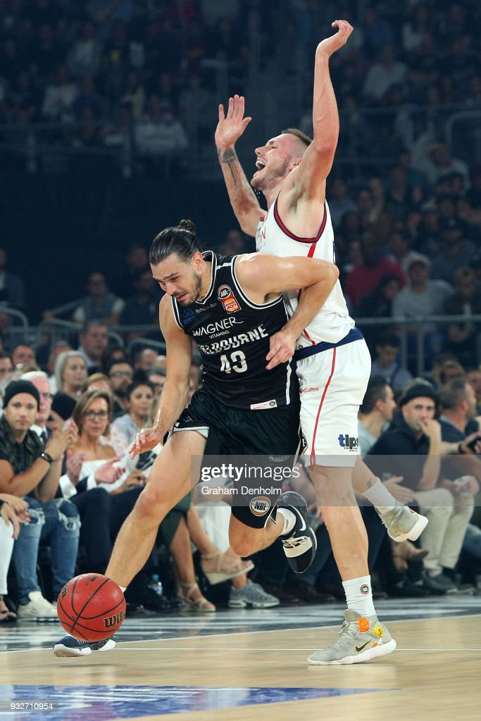 Chris Goulding of Melbourne United (L) drives past Mitch Creek of the Adelaide 36ers during game one of the NBL Grand Final series between Melbourne United and the Adelaide 36ers at Hisense Arena on March 16, 2018 in Melbourne, Australia.