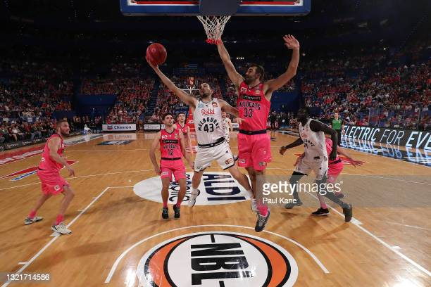 Chris Goulding of Melbourne United goes to the basket against John Mooney of the Wildcats during the round 21 NBL match between the Perth Wildcats...
