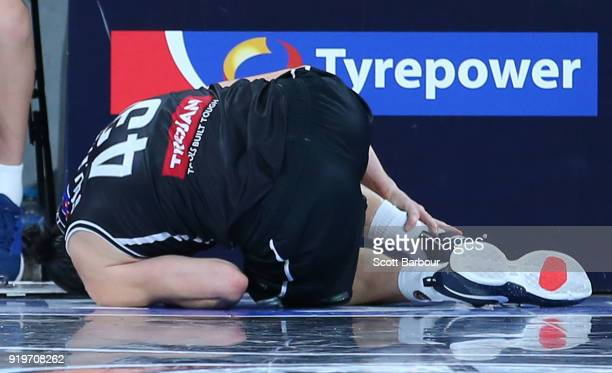 Chris Goulding of Melbourne United leaves the court injured during the round 19 NBL match between Melbourne United and the Illawarra Hawks at Hisense...