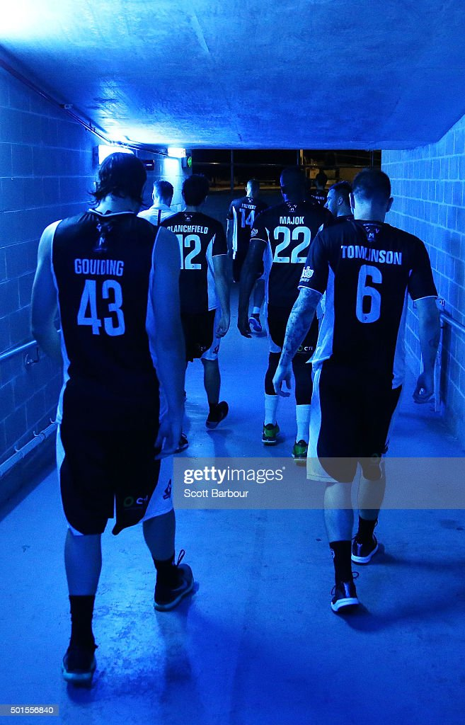 Chris Goulding of Melbourne United, Nate Tomlinson of Melbourne United and their teammates leave their changing room to enter the arena during the round 11 NBL match between Melbourne United and Sydney Kings at Hisense Arena on December 16, 2015 in Melbourne, Australia.