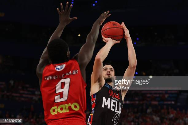 Chris Goulding of Melbourne United puts a shot up against Wani Swaka Lo Buluk of the Wildcats during game one of the NBL Grand Final Series between...