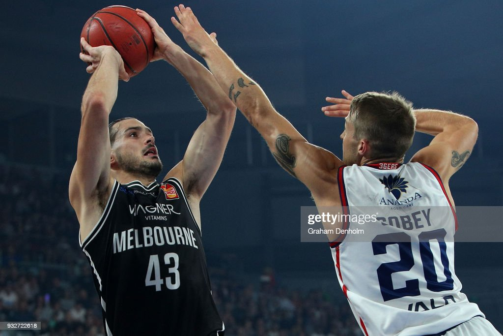 Chris Goulding of Melbourne United (L) shoots during game one of the NBL Grand Final series between Melbourne United and the Adelaide 36ers at Hisense Arena on March 16, 2018 in Melbourne, Australia.