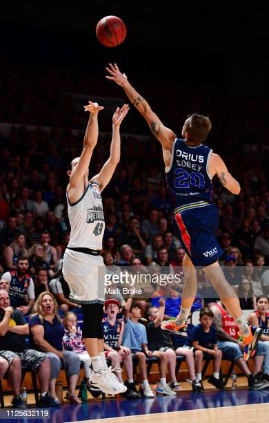 Chris Goulding of Melbourne United shoots for three guarded by Nathan Sobey of the Adelaide 36ers during the round 15 NBL match between the Adelaide...