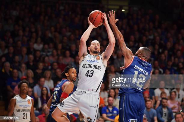 Chris Goulding of Melbourne United shoots over Shannon Shorter of the Adelaide 36ers during game two of the NBL Grand Final series between the...