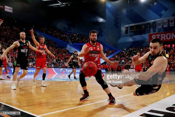 Chris Goulding of Melbourne United throws the ball back in play as he slides off the court during game one of the NBL Grand Final Series between the...