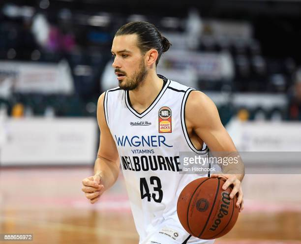 Chris Goulding of Melbourne United warms up before the start of the round nine NBL match between the Cairns Taipans and Melbourne United at Cairns...