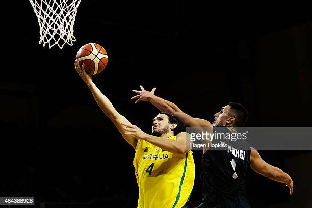 Chris Goulding of the Boomers lays up under pressure from Reuben Te Rangi of the Tall Blacks during the game two match between the New Zealand Tall...