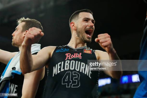 Chris Goulding of United cheers from the bench during the round 10 NBL match between Melbourne United and the Adelaide 36ers at Melbourne Arena on...