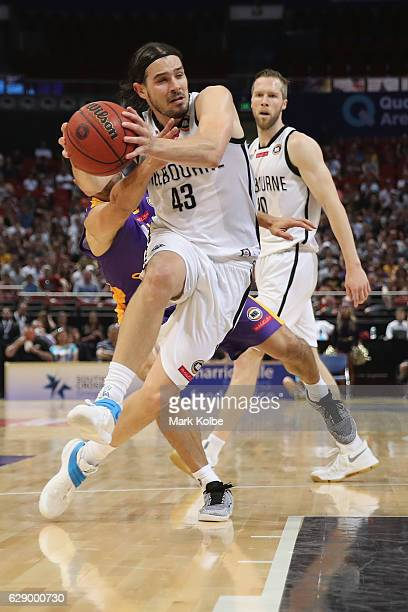 Chris Goulding of United drives to the basket under pressure from Bernie Ibiniof the Kings during the round 10 NBL match between the Sydney Kings and...