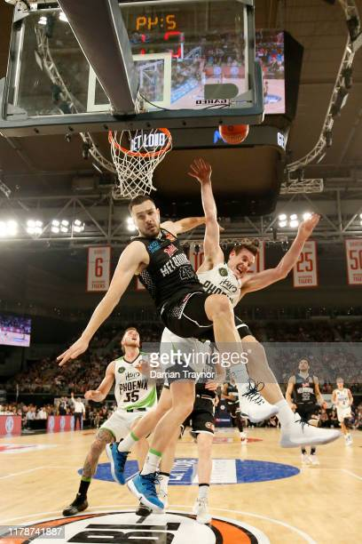 Chris Goulding of United fouls Ben Madgen of the Phoenix as he drives to the basket during the round one NBL match between Melbourne United and the...
